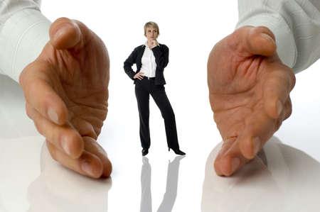 between: business women standing between male hands concept