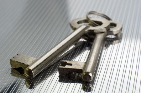 metalic background: two keys close up on metalic background