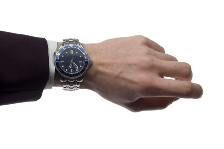 business man hand with wrist watch on white photo