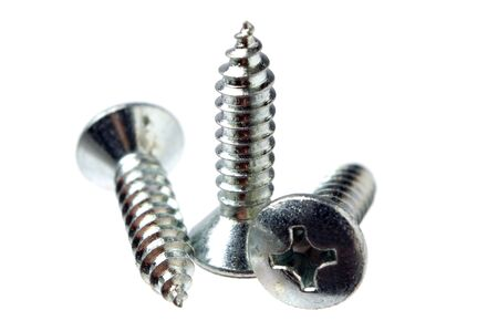 Three screws on white background close up shoot photo