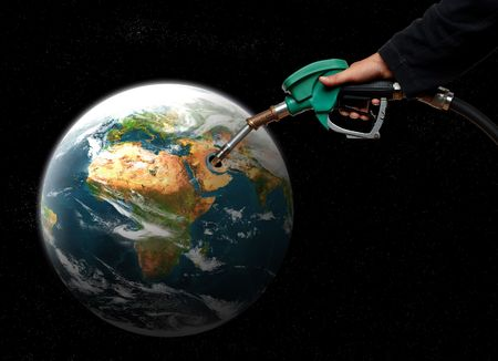 hand filling fuel in planet earth concept photo