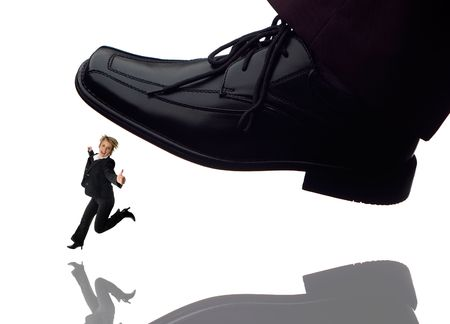 men shoe stepping on business women concept on white photo
