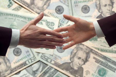 business handshake with money bills in background photo