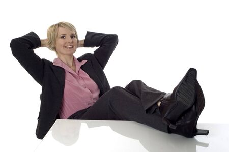 feet on desk: young business women sitting and relaxing on white Stock Photo