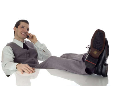 young business men sitting and talking on mobile phone photo