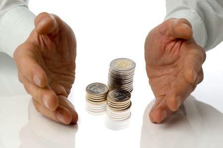 thrive: eur coins between business men hands concept
