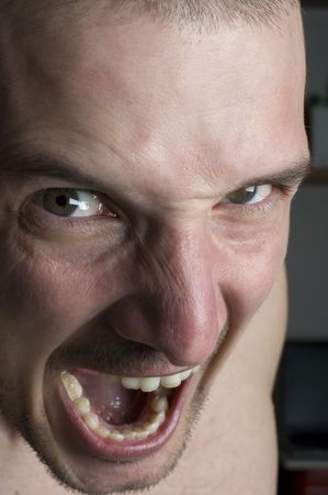deranged: very angry mens face close up shoot Stock Photo