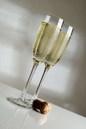 Two champagne glasses filled with sparkling champagne close up Stock Photo - 765712