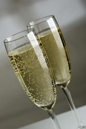 Two champagne glasses filled with sparkling champagne close up Stock Photo - 765711