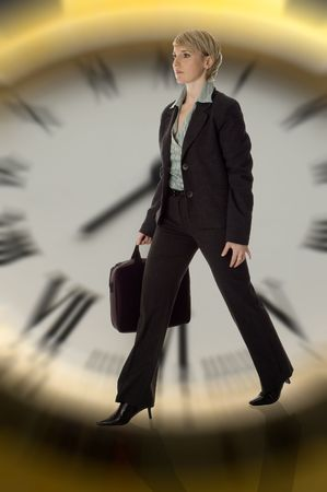 business women with case walking with clock in background photo
