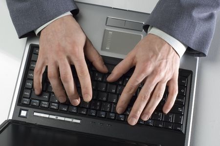business men working on laptop close up photo