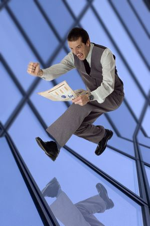 business men jumping with newspaper in hands - success concept Stock Photo - 777930