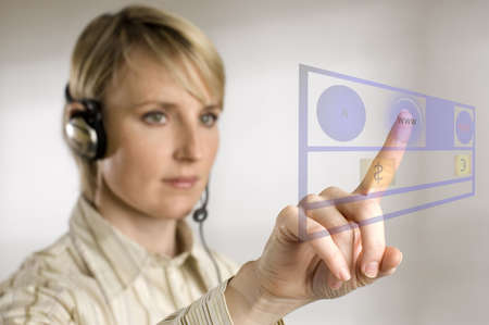 young business women pressing button on the screen photo
