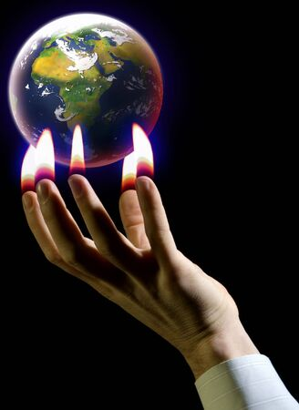 hand and planet earth global warming concept