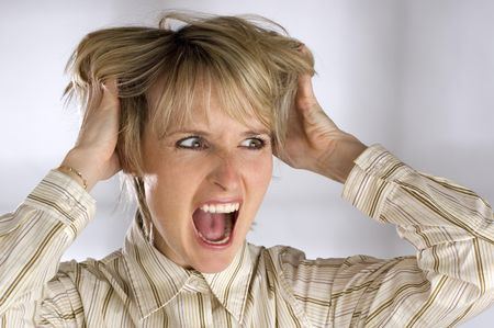 cranky: young business women grabbing her hair angry expression Stock Photo
