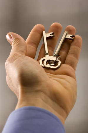 keys to heaven: keys in business men hand close up