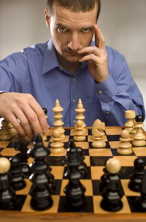 young business men playing chess portrait shoot photo
