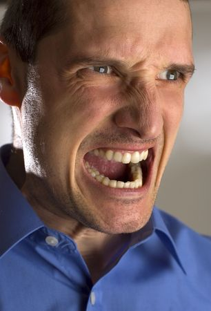 lunatic: business men angry expression close up shoot