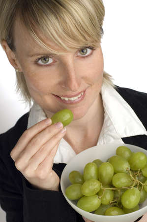 young blond women eating green grape close up Stock Photo - 857049