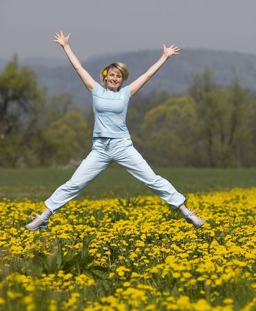 young happy woman jumping on a field Stock Photo - 870229