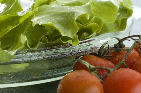 fresh green salad with cherry tomatos beside close up Stock Photo - 894693