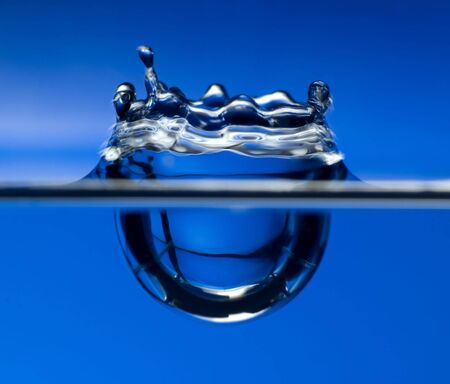 water drop on blue background close up