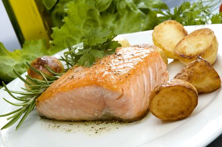 baked salmon steak with potato and rosemary photo