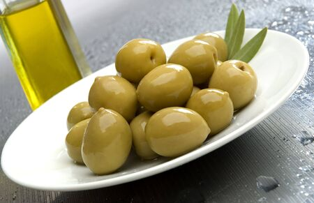 greek chef: olive fruit on a plate with olive oil in background