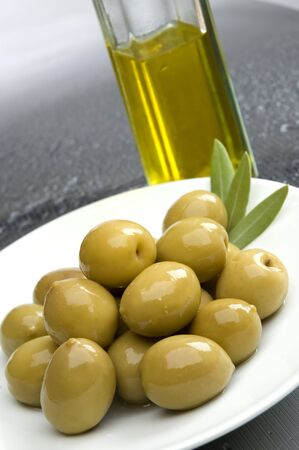 greek chef: olive fruit on a plate with olive oil in background-vertical shoot