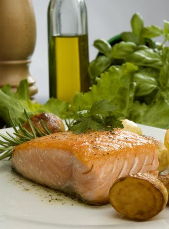 baked salmon steak with rosemary and potato on a plate Stock Photo - 952785