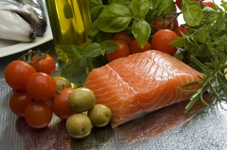 raw salmon steak with vegetables and olive oil in background Stock Photo - 952788