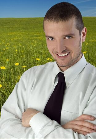 smiling businessman standing in the green outdoors Stock Photo - 991394