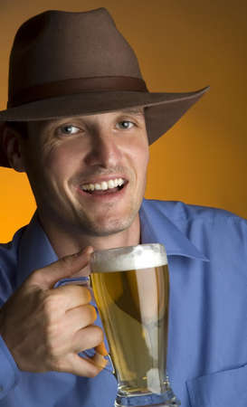 young men with hat drinking cold beer portrait Stock Photo - 1050229