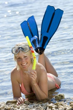 snorkle: woman on the beach with fins and snorkle