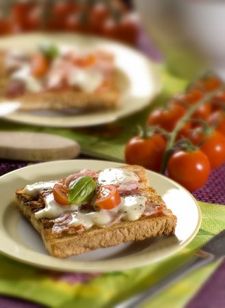 ham and cheese: toast bread with ham cheese tomato and basil close up