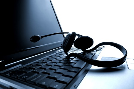 backing: laptop computer with headset close up shoot