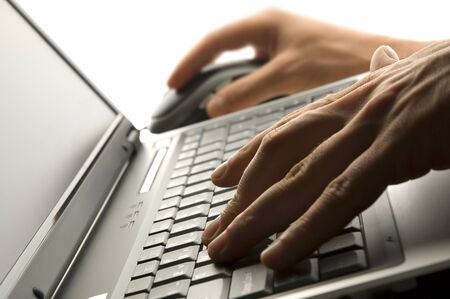 male hands typing on a laptop close up photo