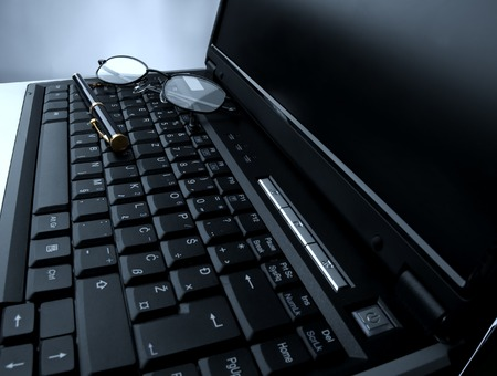 pencil and glasses on laptop close up Stock Photo - 1483492