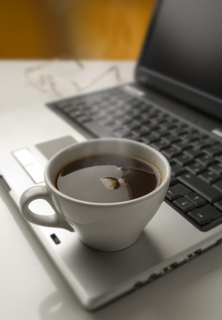 cup of hot coffee on a  laptop close up Stock Photo - 1525452