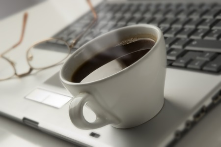 cup of hot coffee on a  laptop close up Stock Photo - 1525453
