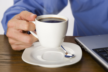 businessmen holding cup of hot coffee close up Stock Photo - 1525465