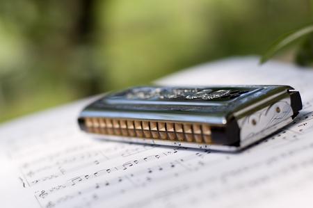 harmonica: mouth harmonica on sheet music close up Stock Photo