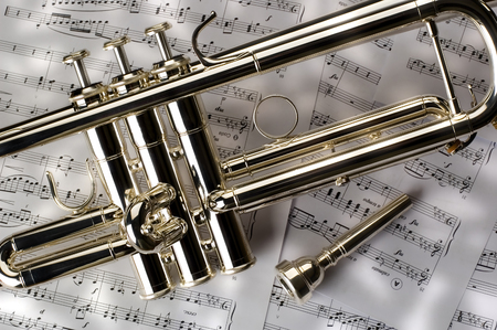 tune: Trumpet on musical notes as background close up