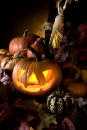 halloween pumpkin with autumn leaves close up Stock Photo