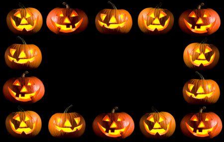 black frame made of carved halloween pumpkins photo