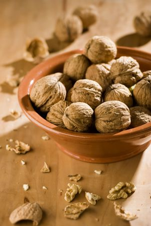 dried walnuts in a bowl close up shoot