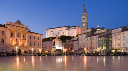curch: old town in Slovenia Piran at dusk  Stock Photo