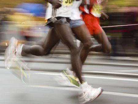sync: fast marathon runners slow sync close up shoot Stock Photo