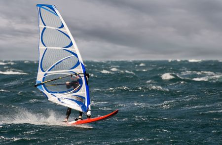 recreate: windsurfer on a stormy day close up shoot Stock Photo
