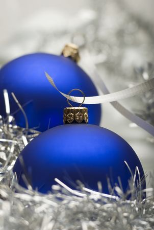 matte: blue christmas ornaments on silver close up shoot